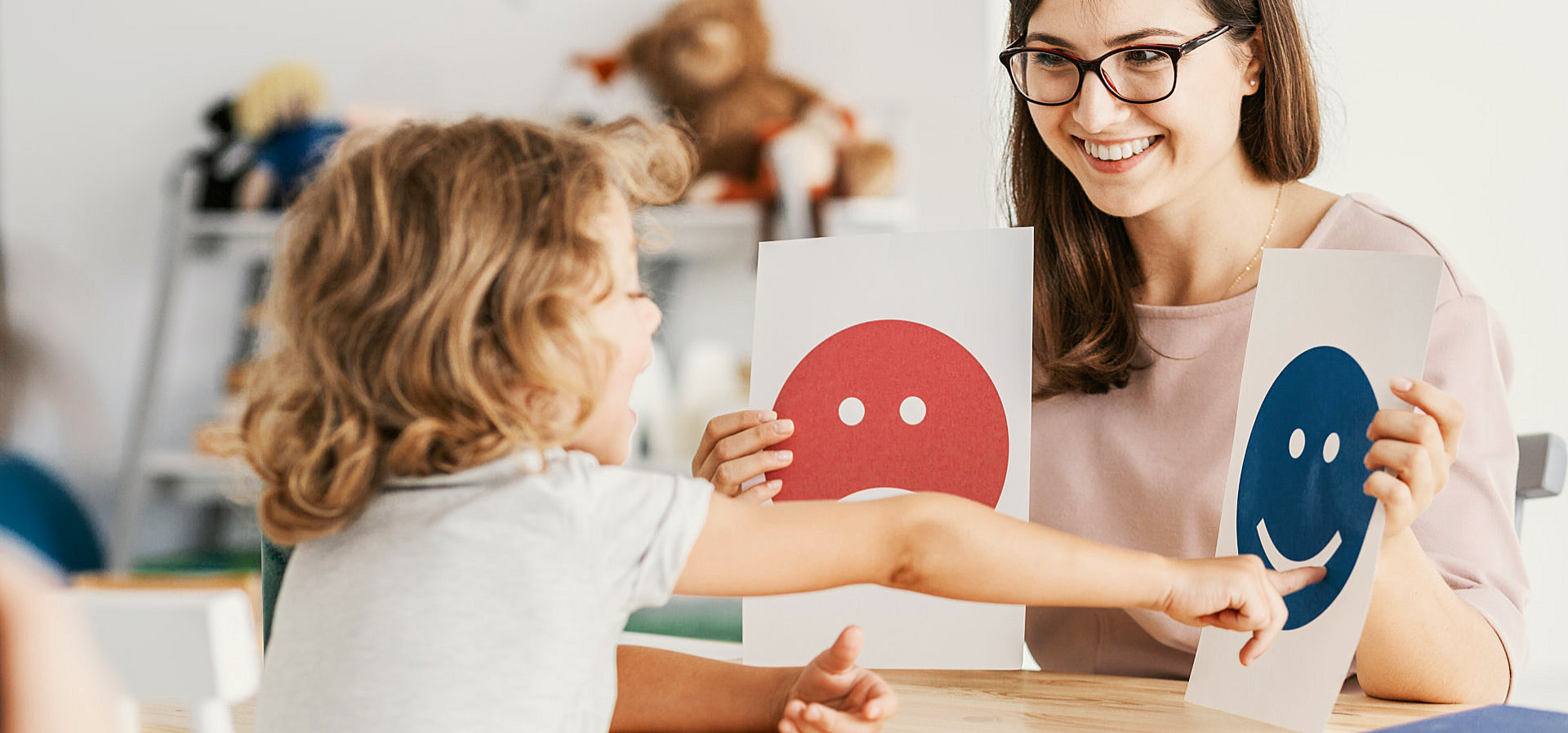 professional woman teaching the little girl smiling